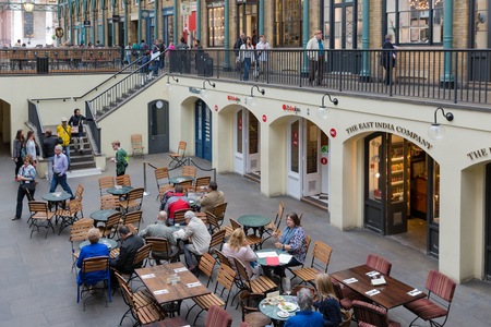 LONDON, ENGLAND - JUNE 08, 2017: Covent Garden market in London. This tourist attraction in London is famous about its restaurants, pubs, market stalls and shops.
