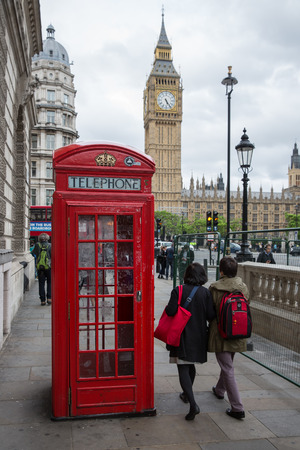 LONDON, ENGLAND - JUNE 08, 2017: People and call box at Parliament square near Big Ben in London, UK