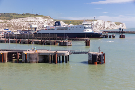 English harbor of Dover with jetty and ferry