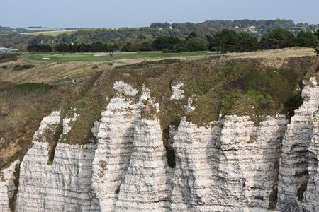 Rural landscape with limestone cliffs near Etretat in Normandy, France