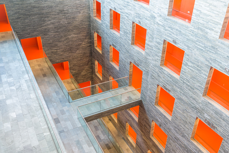 Interior modern museum building with several floors and orange painted passages Stock Photo