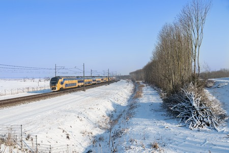 Dutch train in snowy winter landscape Stockfoto