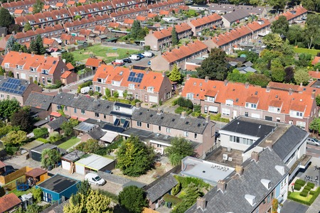 Aerial view family houses with backyards in residential area of Dutch village Emmeloord