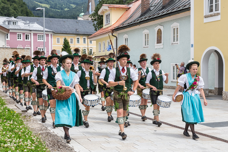 BERCHTESGADEN, GERMANY - JULY 09, 2017: Local festival with parade of fanfare and people dressed in traditonal costumes. Every village from the neighbourhoud has his own costumes.