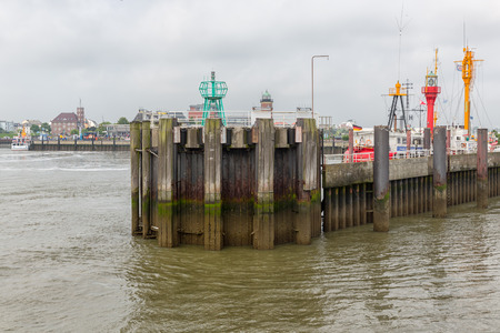 Cuxhaven, Germany - May 19, 2017: German harbor Cuxhaven with pier and profile of former lightship ELBE1 Editorial
