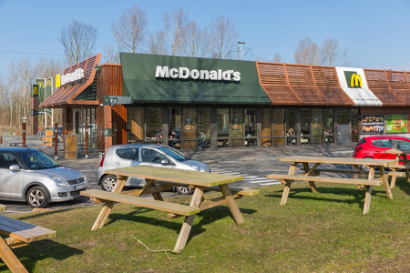 Lelystad, The Netherlands - February 22, 2018 Car park near Dutch motorway with fastfood restaurant Mc Donalds Editorial