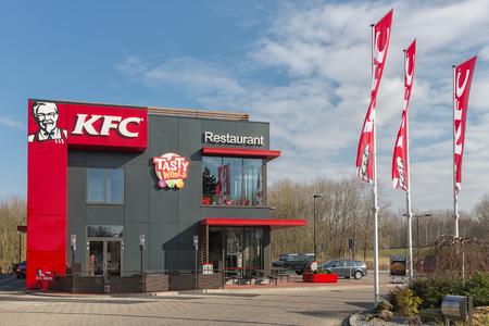 Lelystad, The Netherlands - February 22, 2018: Car park near Dutch motorway with KFC fastfood restaurant