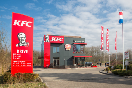 Lelystad, The Netherlands - February 22, 2018: Car park near Dutch motorway with KFC fastfood restaurant