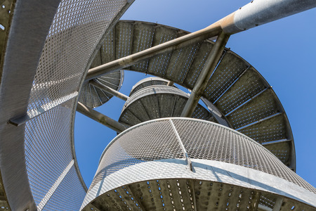 Detail of watch tower made of two twisted steel spiral staircases near Lelystad Airport in The Netherlands