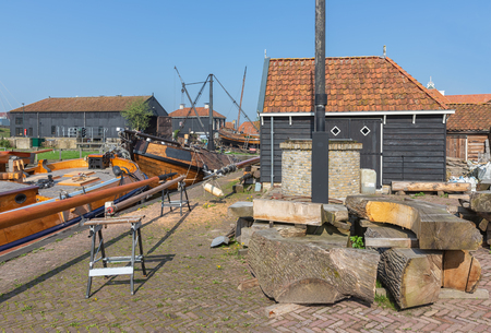 Historical ships anchored near shipyard in harbor Dutch fishing village Workum Stock Photo
