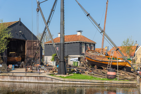 Historical ships at shipyard with slipway in harbor Dutch fishing village Workum