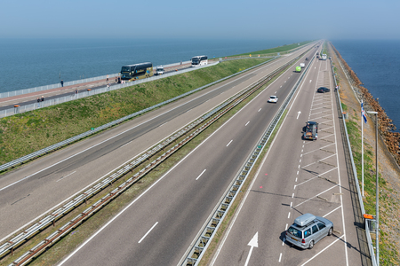 Wieringen, The Netherlands - April 20, 2018: Dutch highway at the afsluitdijk. The dike is the connection between Friesland and Noord-Holland and separates the Waddensea from the IJsselmeer Editorial