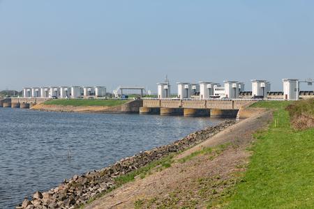 Sluices in Dutch Afsluitdijk near Kornwerderzand for draining fresh water of the lake IJsselmeer to the salt Wadden Sea Stockfoto