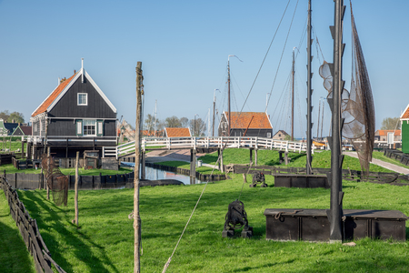 Traditional houses of a fishing village with nets drying in the wind - Enkhuizen, The Netherlands