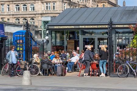 Edinburgh, Scotland - May 24, 2018: Restaurant near Waverley station with people sitting outside at the terrace Editorial