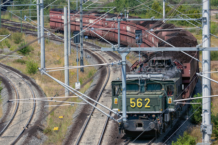Hambach lignite mine, Germany - June 28 2018: German train transporting brown coals from Hambach open pit mine to power plant