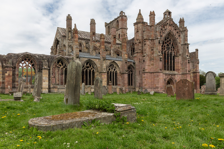 View at graveyard and ruins of Melrose abbey in Scottish borders