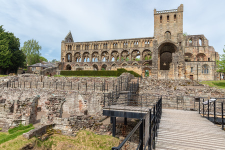 Catwalk to medieval ruins of Jedburgh abbey in Scottish borders. Stock Photo