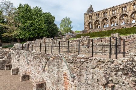 View at wall and ruins of Jedburgh abbey in Scottish borders