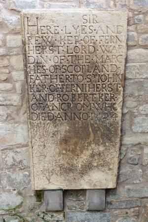 Jedburgh, Scotland - May 18 2018: Tombstone near ruins of Jedburgh Abbey in Scottish borders