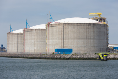 Rotterdam, The Netherlands - June 5, 2018: Oil storage tanks in Dutch harbor Rotterdam, biggest seaport of Europe