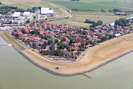 Aerial view Dutch village Hindeloopen at lake IJsselmeer with marina harbor and residential area Stok Fotoğraf