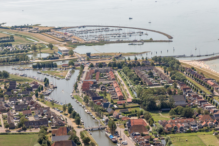 Aerial view Dutch village Stavoren at lake IJsselmeer with residential area and marina harbor