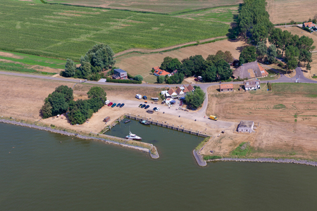 Aerial view small harbor Laaksum in agricultural landscape of Dutch province Friesland Banque d'images
