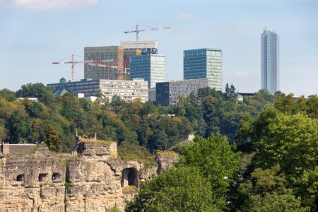 Luxembourg city, the capital of Grand Duchy of Luxembourg, aerial view at old medieval casemates and kirchberg with office buildings European Union