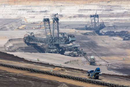 Brown coal open pit landscape with enormous digging excavator in Garzweiler mine Germany Stock Photo