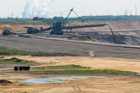 Brown coal open pit landscape with enormous digging excavator in Garzweiler mine Germany Imagens