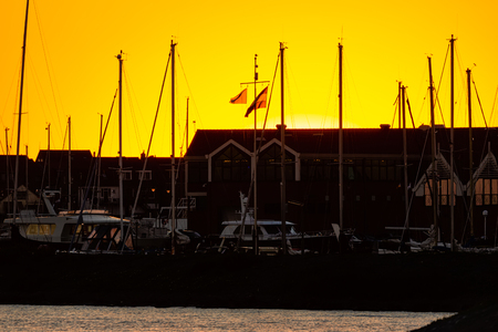 Sunset with skyline silhouet Urk, fishing village in the Netherlands Stock Photo
