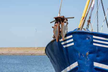 Ship bow with anchor of shrimp fishing ship in Dutch harbor Lauwersoog