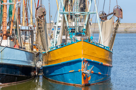 Shrimp fishing boat with rigging and drying nets in Dutch harbor Lauwersoog