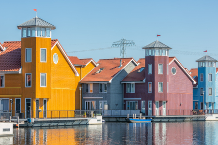 Waterfront with colorful wooden houses in Reitdiep harbor, Groningen, The Netherlands Stock Photo