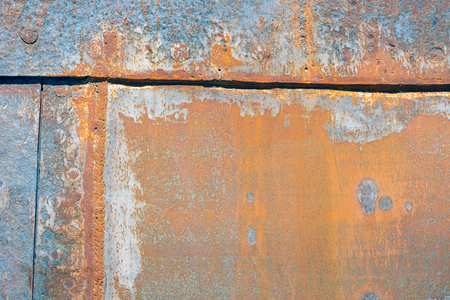 Background of rusty plating of ship at shipyard for maintenance