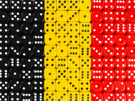 National flag of Belgium in colorful background of dices