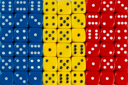 National flag of Romania in colorful background of dices Stock Photo