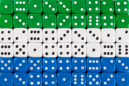 National flag of Sierra Leone in colorful background of dices