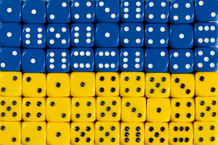 National flag of Ukraine in colorful background of dices Stock Photo