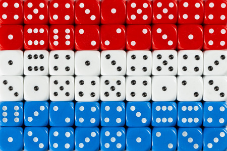 National flag of Yemen in colorful background of dices Stock Photo