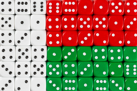 National flag of Madagaskar in colorful background of dices Stock Photo