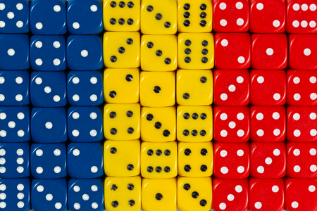 National flag of Chad in colorful background of dices, capital city NDjamena Stock Photo
