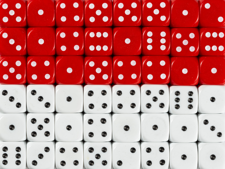 National flag of Monaco in colorful background of dices Stock Photo
