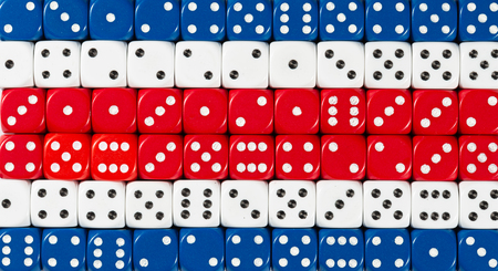 National flag of Costa Rica in colorful background of dices Stock Photo