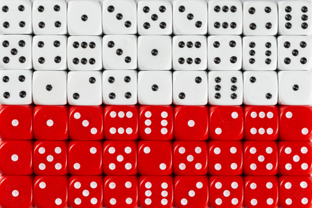 National flag of Poland in colorful background of dices Stock Photo