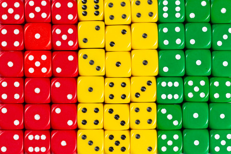 National flag of Guinea in colorful background of dices