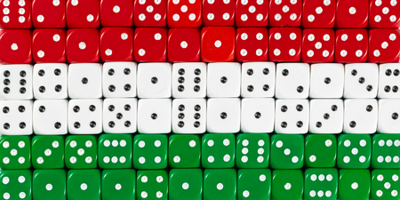 National flag of Hungary in colorful background of dices Stock Photo