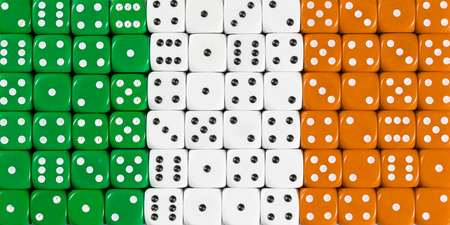 National flag of Ireland in colorful background of dices Stock Photo