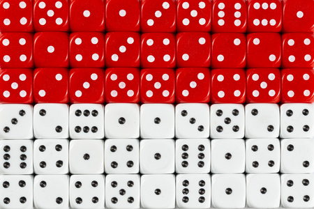 National flag of Indonesia in colorful background of dices